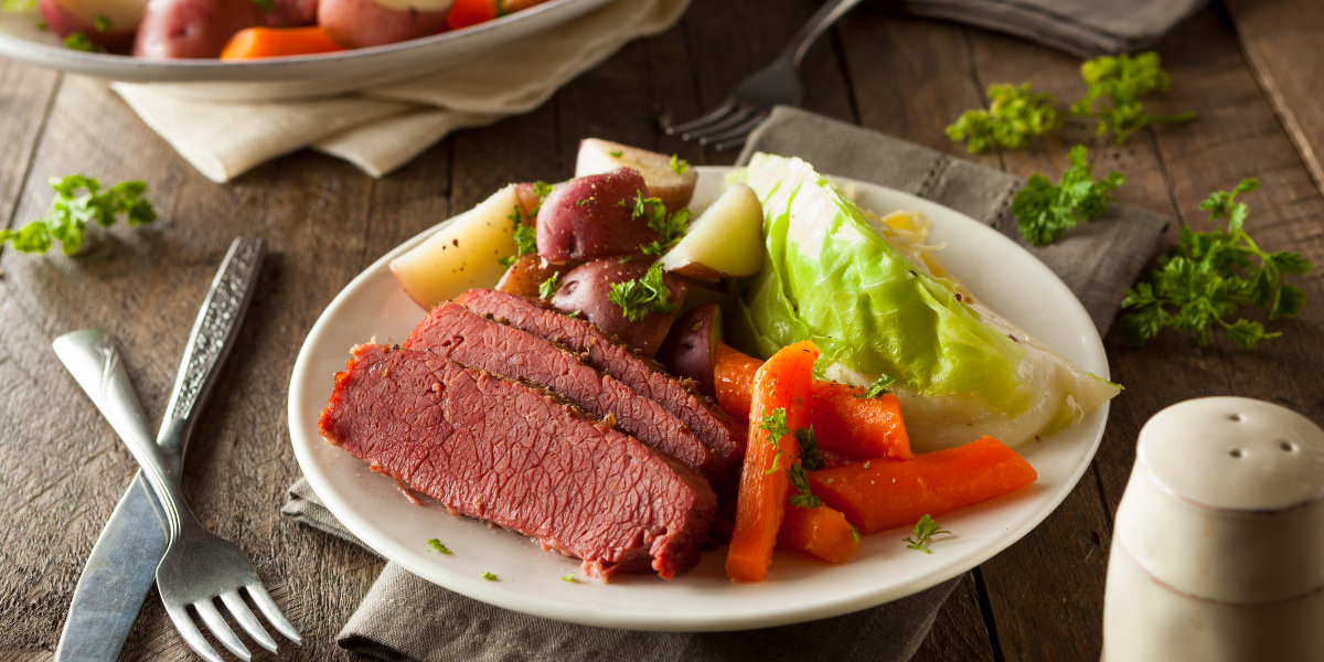 picture of corned beef and cabbage on a dinner table