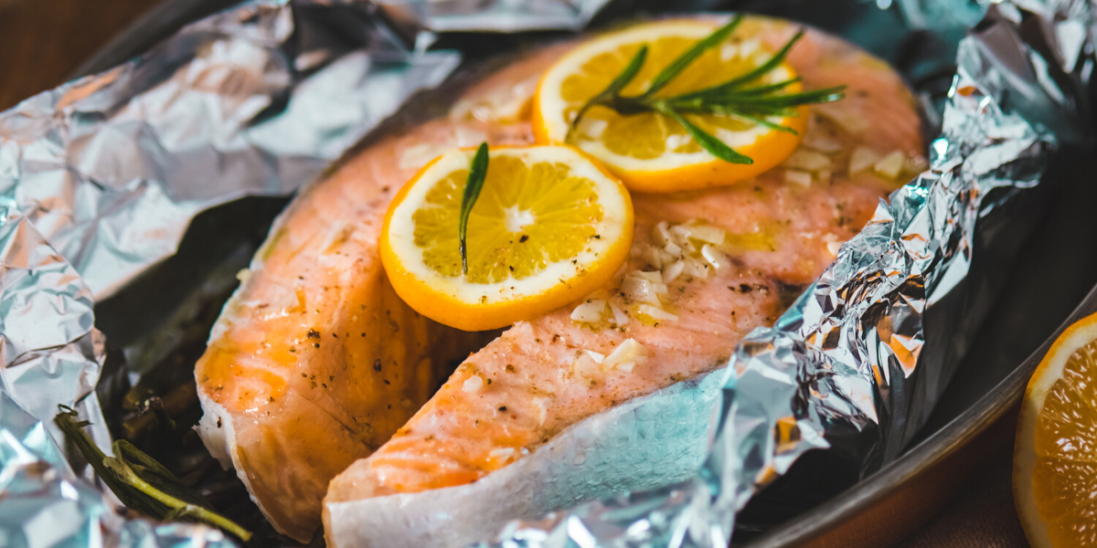 Salmon the grill garnished with rosemary and lemon