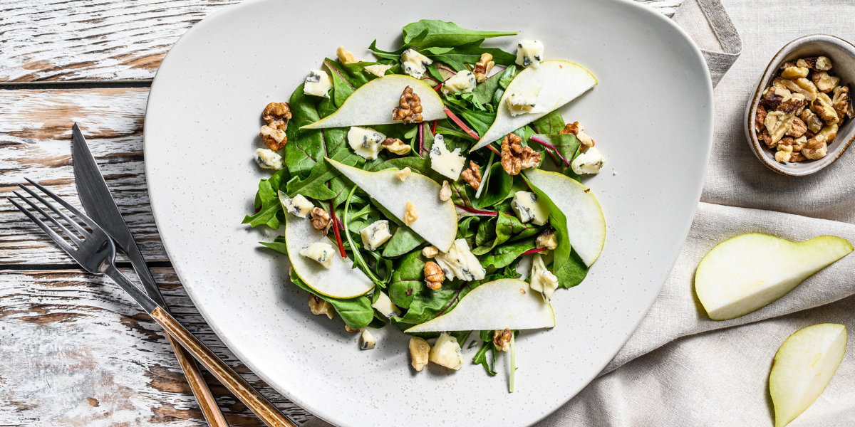 Picture of pear and walnut salad on a dinner table